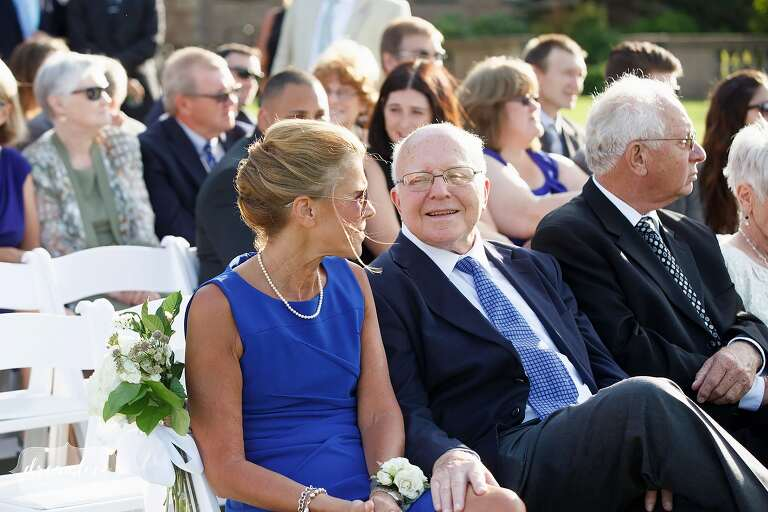 Parents laughing before outdoor wedding ceremony at Crane Estate on the north shore of MA.