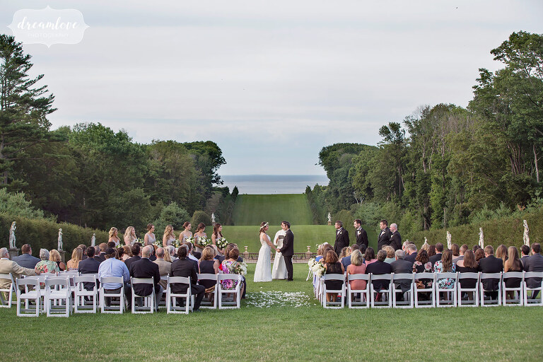 View of the outdoor ceremony site on the front lawn of the majestic Crane Estate wedding venue on the north shore of MA.