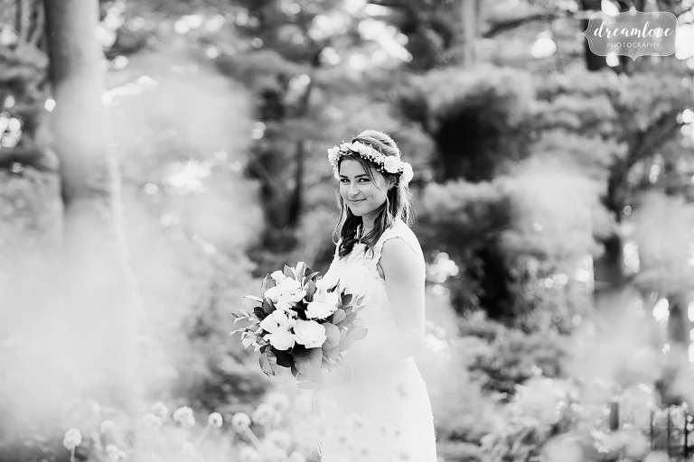 Artsy wedding black and white photo of the bride in the garden at the Crane Estate on Castle Hill.