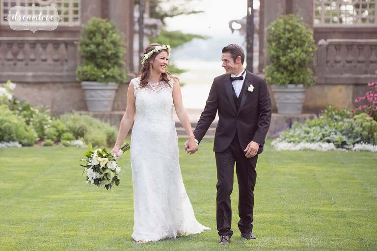 Bride and groom walk through the Italian Garden area at this epic wedding venue in Ipswich, MA.