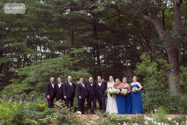 The wedding party lines up in the forest at the Moraine Farm Estate.