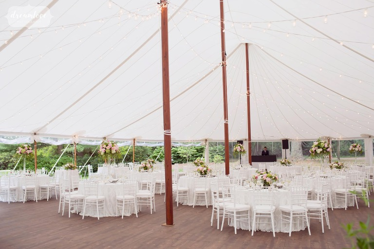 Example of dinner tables set up in the sailcloth tent for a reception at the Moraine Farm in MA.
