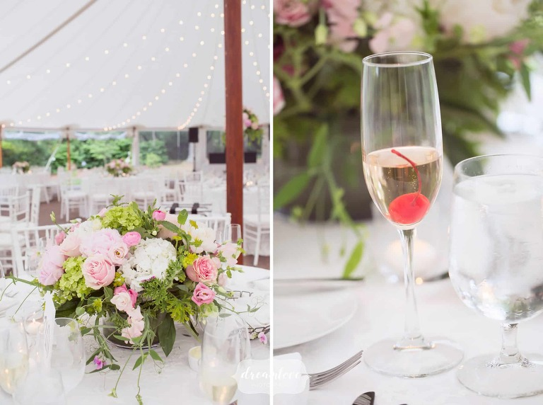 Table details at Moraine Farm with organic centerpieces with white, pink and green florals.