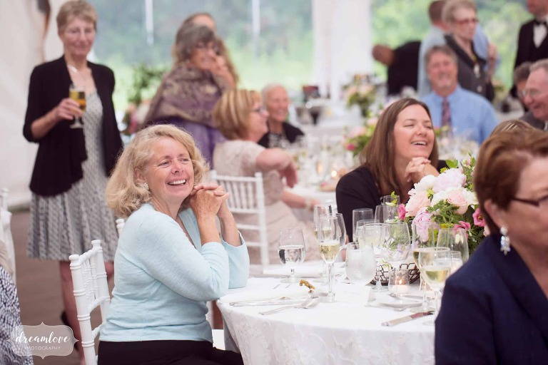 Candid wedding photos of guests watching bride and groom's first dance at Moraine Farm.