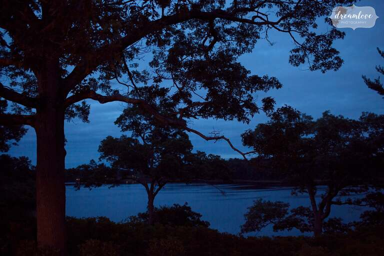 Blue light blankets the lake at dusk at the Moraine Farm Estate wedding venue in MA.