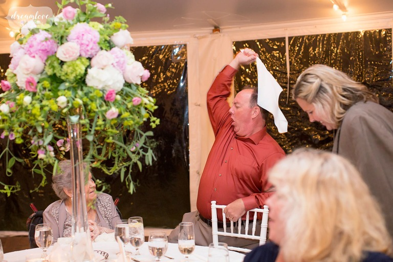 Hilarious photo of a wedding guest swinging a napkin and doing dirty dance moves at the Moraine Farm Estate venue in MA.