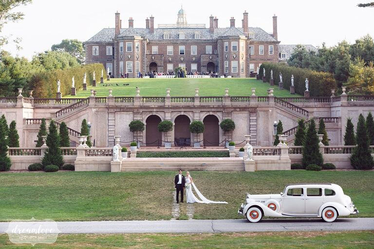 Bride and groom stand in front of the Great House on Castle Hill before their Crane Estate coastal wedding in MA.