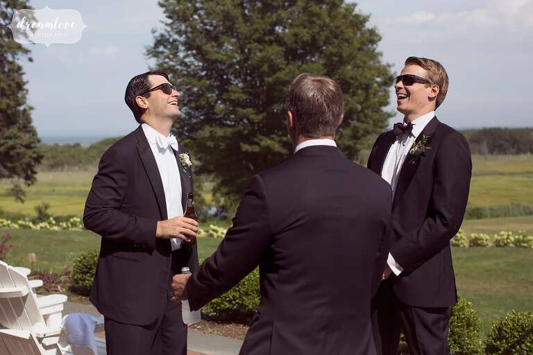 Guys laugh while getting ready at the Inn at Castle Hill in Ipswich, MA.