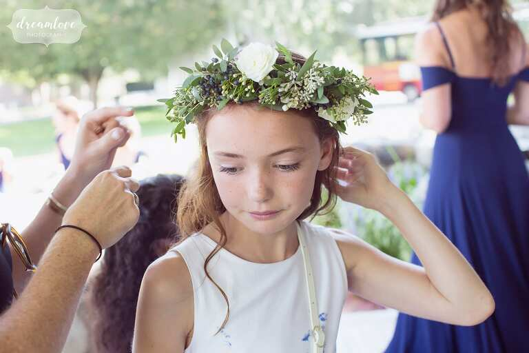 Flower girl puts on her crown before the Crane Estate wedding on the northshore.