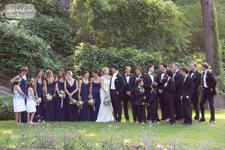 The wedding party poses in the Italian Garden in Vera Wang in MA.
