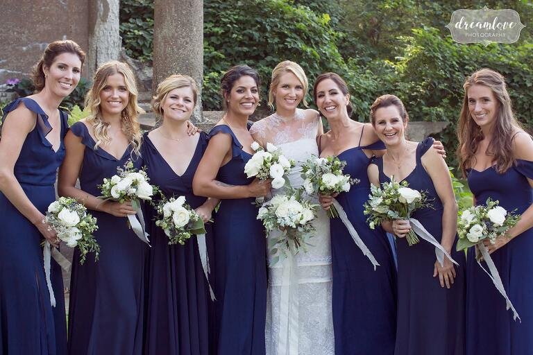 The bridal party poses in the garden at the Crane Estate.