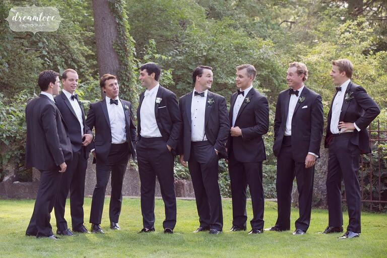 Groomsmen pose in tuxedos by Ralph Lauren at the Crane Estate.
