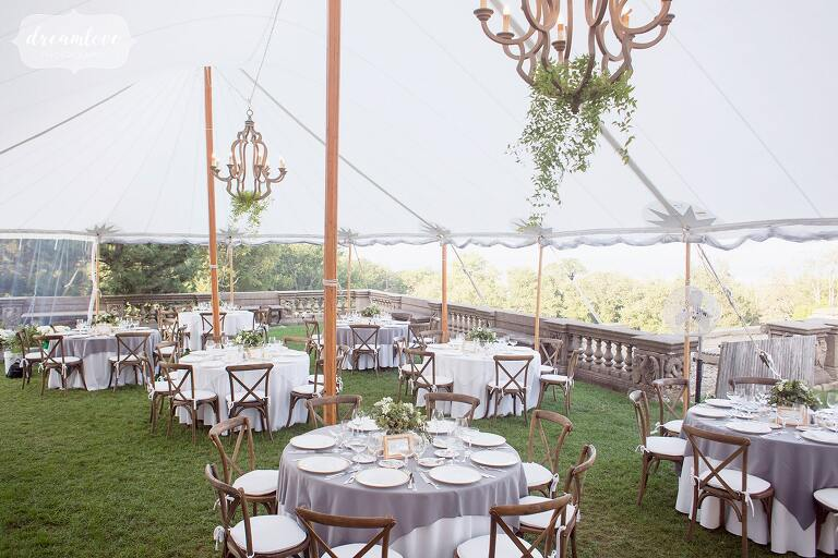 Example of round tables set up for dinner under the tent at the Crane Estate in MA.