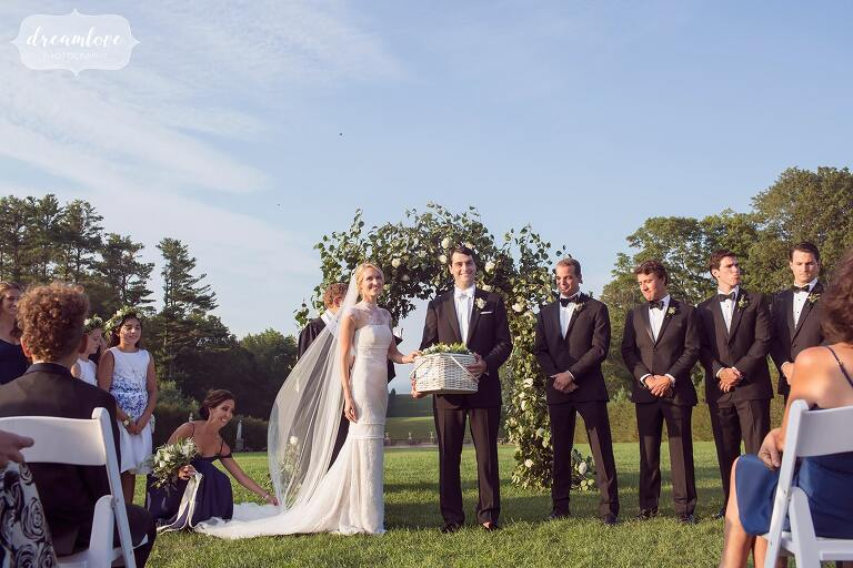 The bride and groom release white doves during their Crane Estate ceremony overlooking the ocean.
