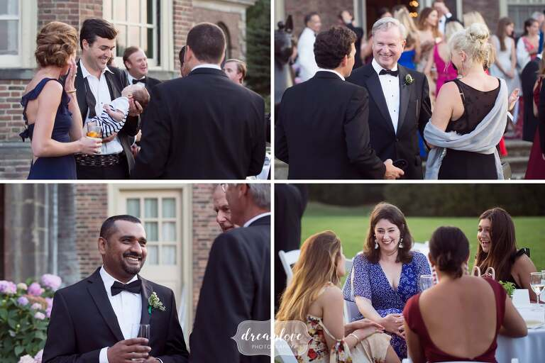 Natural photos of the wedding guests laughing during cocktail hour on the terrace at the Crane Estate.