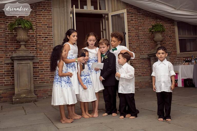 Kids perform during the tented reception at this Crane Estate wedding.