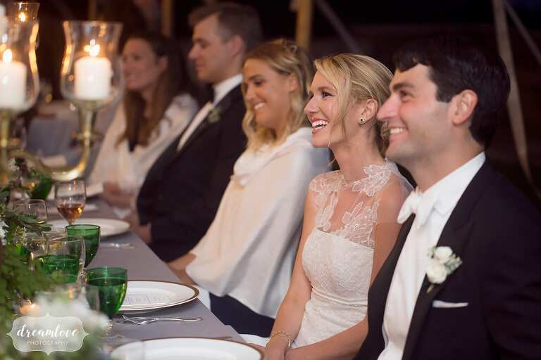 Bride and groom laughing during wedding speeches at the Crane Estate.