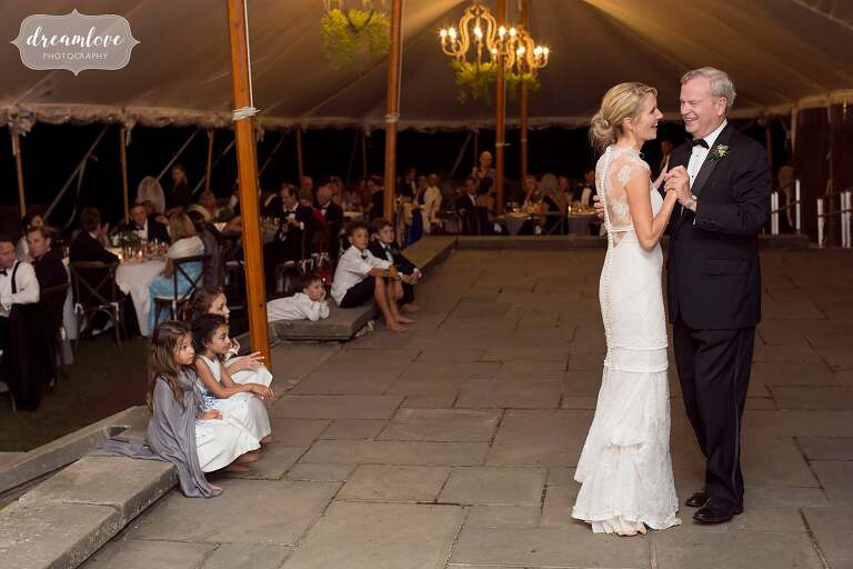 The bride dances with her father under the tent at the Crane Estate.