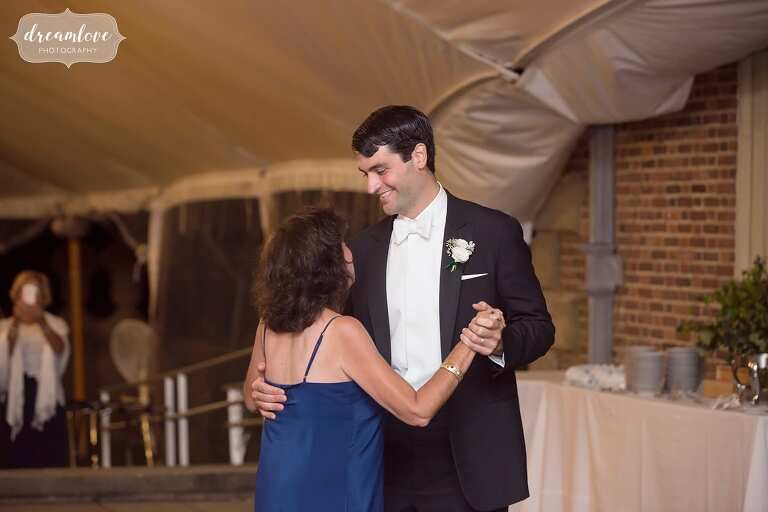 Mother and son dance at tented reception at Crane Estate.