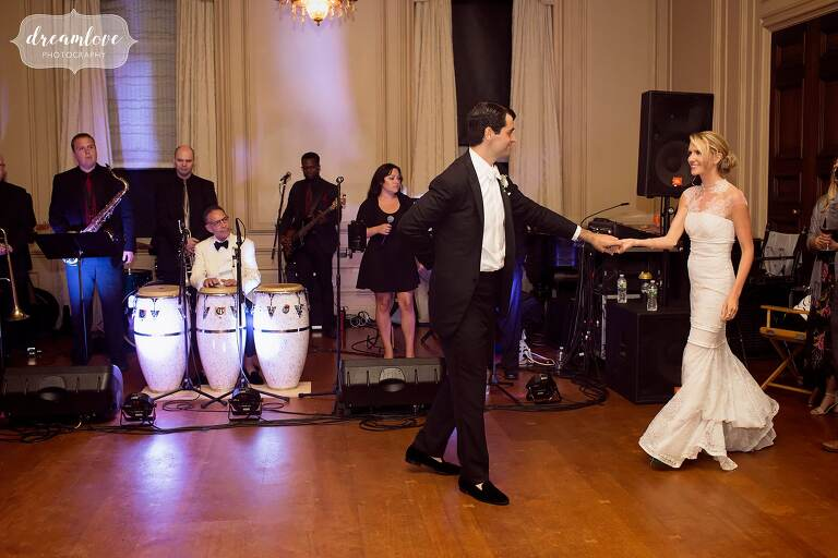 The bride and groom have their first dance at the Crane Estate ballroom in Ipswich, MA.