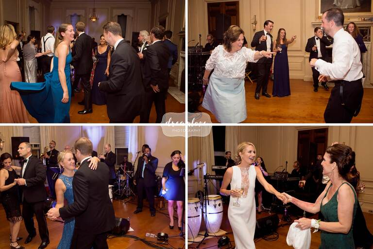 Wedding guests dance on the floor while laughing at Crane Estate.