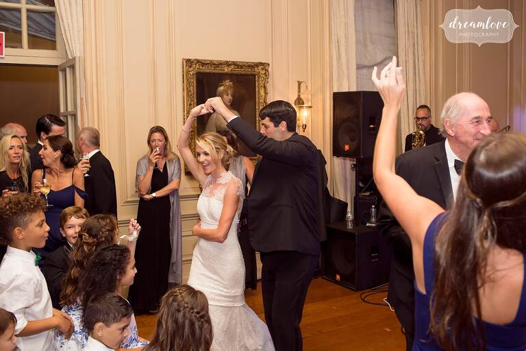 The bride and groom dance in the ballroom at the Great House on Castle Hill.