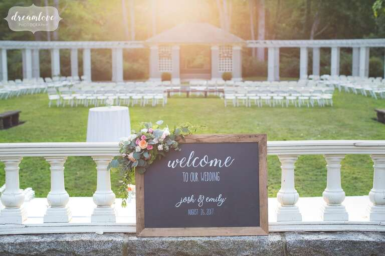 Chalkboard welcome sign for this backyard sunset wedding in Manchester by the Sea, MA.