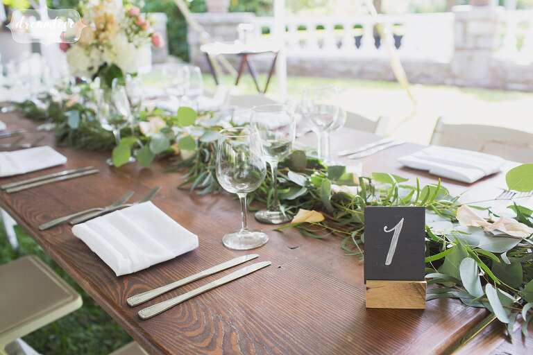 Wooden harvest tables for backyard wedding in Manchester-by-the-Sea.