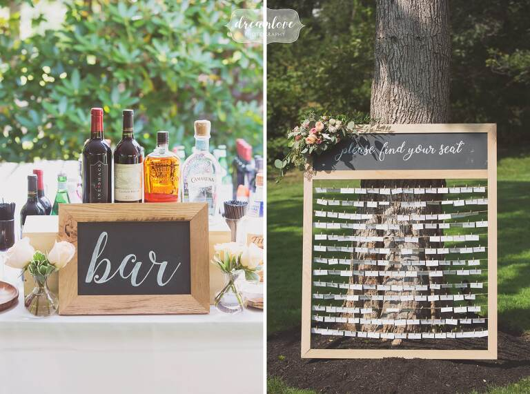 Rustic escort card set up in old picture frame with small clothespins.