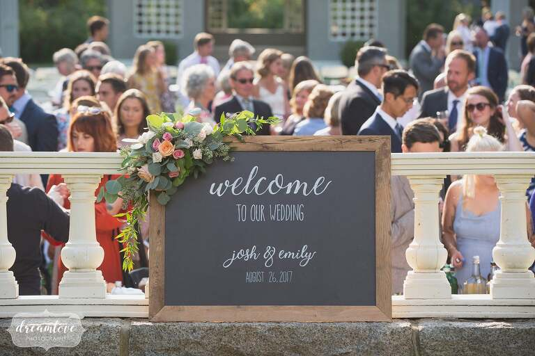 Chalkboard welcome sign in backyard wedding on north shore.