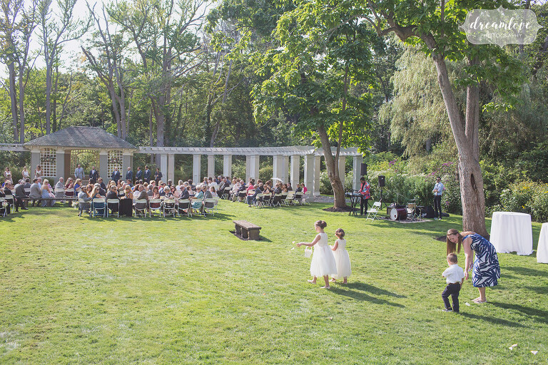 Backyard estate style wedding with flower girls in Manchester by the Sea.