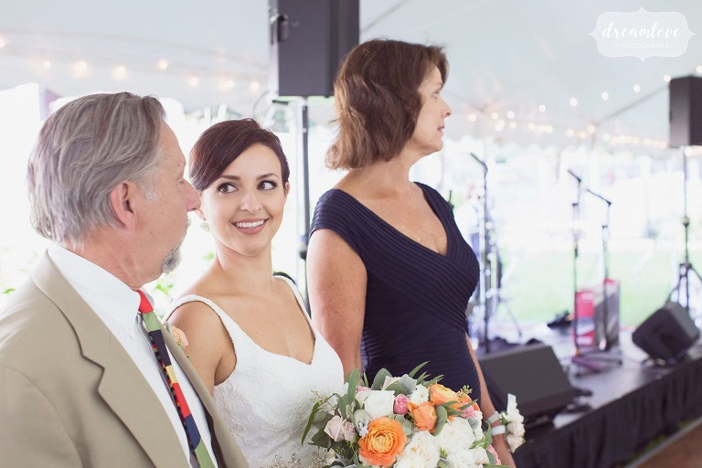 The bride smiles at her father before they walk down aisle.