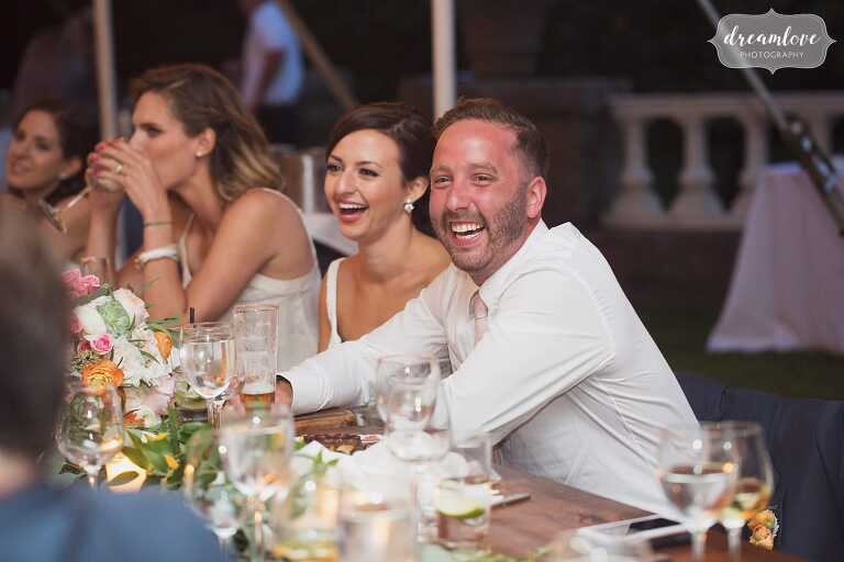 Funny best man speech photos of people laughing at north shore wedding.