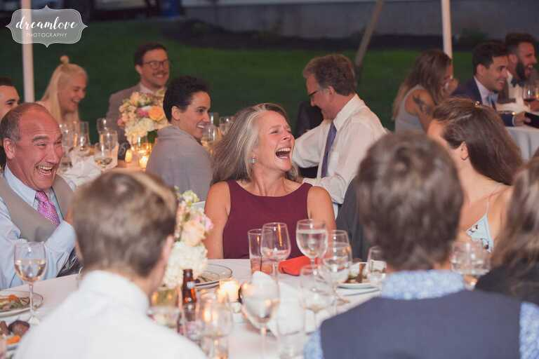 The family laughs during speeches at a north shore wedding.