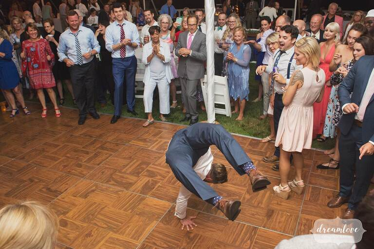 The groom does a back flip on the dance floor at Manchester by the Sea, MA.