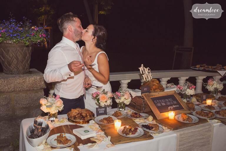 The bride and groom cut their pie for this backyard wedding near Singing Beach.