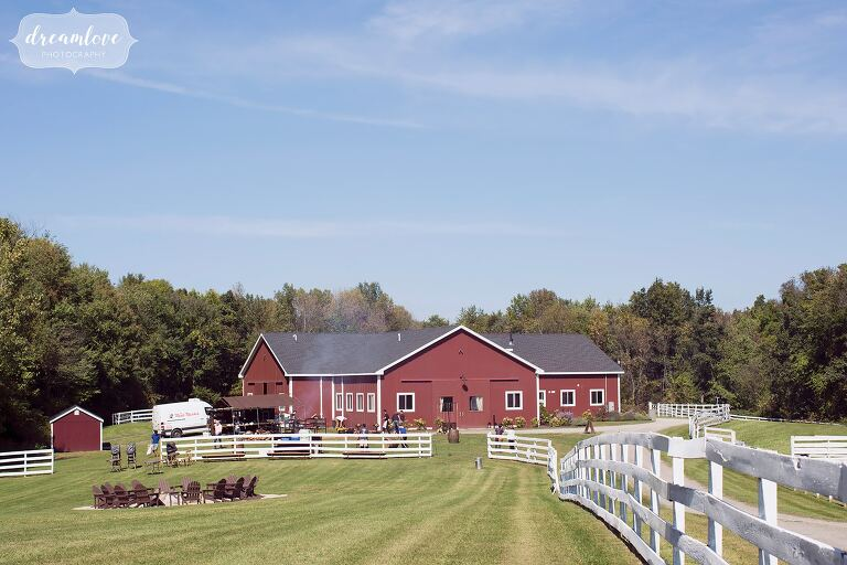 The Barn at Liberty Farms wedding venue has a large field and a rustic red barn for the reception in the Hudson Valley.