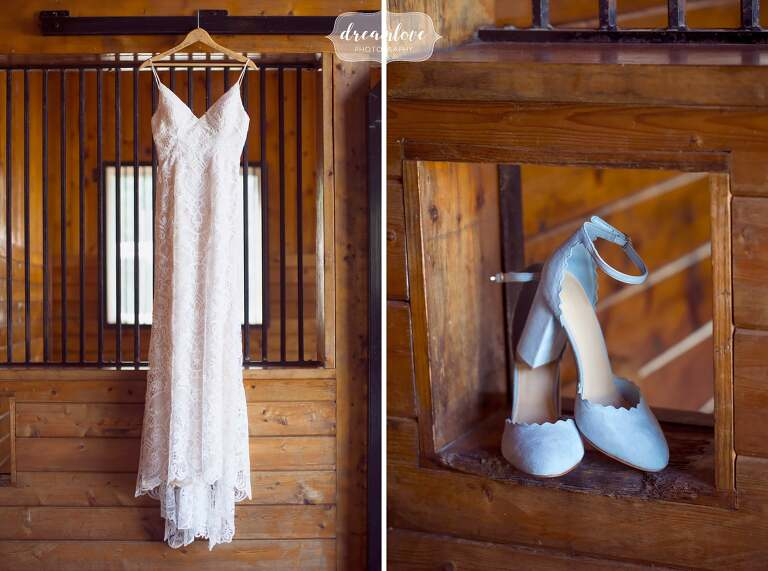 The embroidered wedding dress hangs in the converted horse barn at this Liberty Farms wedding venue in upstate NY.