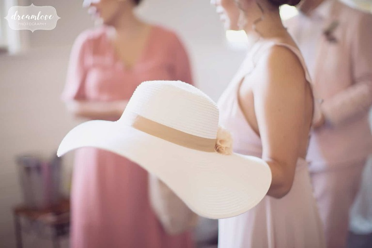 Ethereal wedding photography of a large white sun hat at the Barn at Liberty Farm wedding venue.