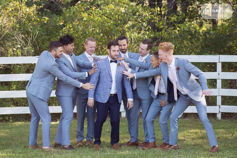 Hipster photography of the groomsmen being funny at this horse barn wedding in Ghent, NY.