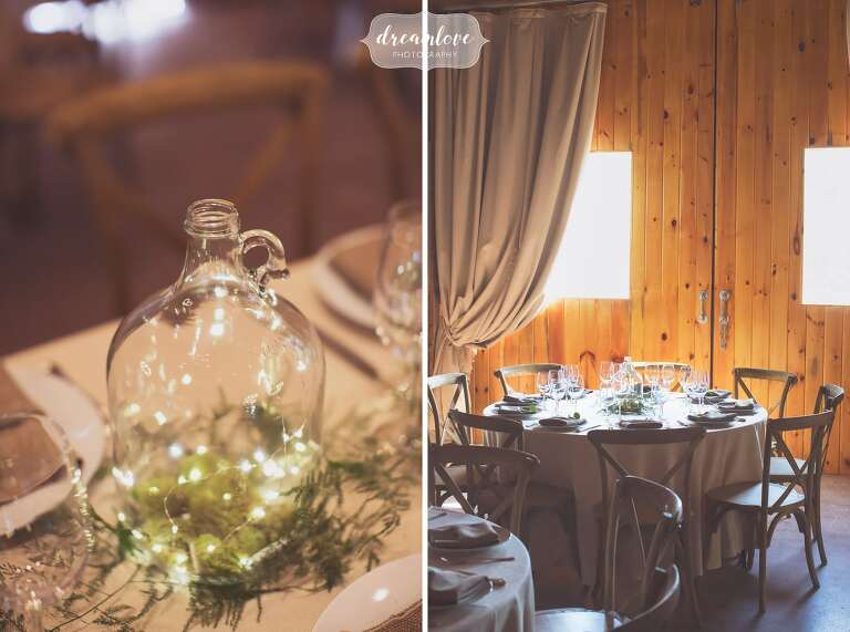 Rustic glass jugs filled with twinkle lights over raw linen napkins at this Barn at Liberty Farms wedding in Ghent, NY.