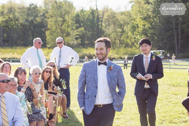 Groom enters outdoor ceremony at the Barn at Liberty Farms venue in Hudson, NY.