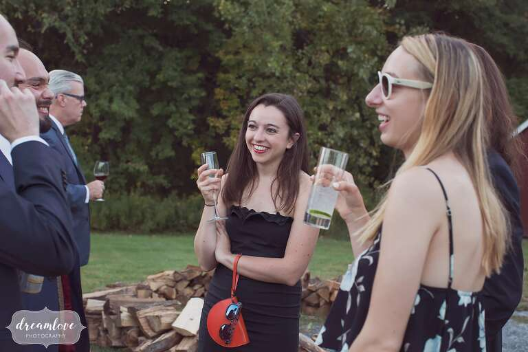 Candid photography of wedding guests at this barn wedding.