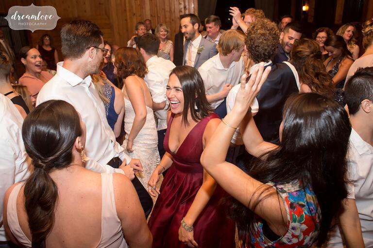 Guests dance like crazy at this Barn at Liberty Farms converted horse barn wedding.