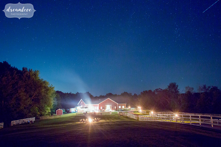 The Barn at Liberty Farms wedding venue with a starry blue sky at dusk in Ghent, NY.