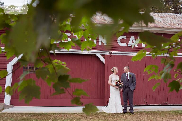 This barn wedding in the white mountains had a beautiful red barn where the bride and groom could pose at Bishop Farm.