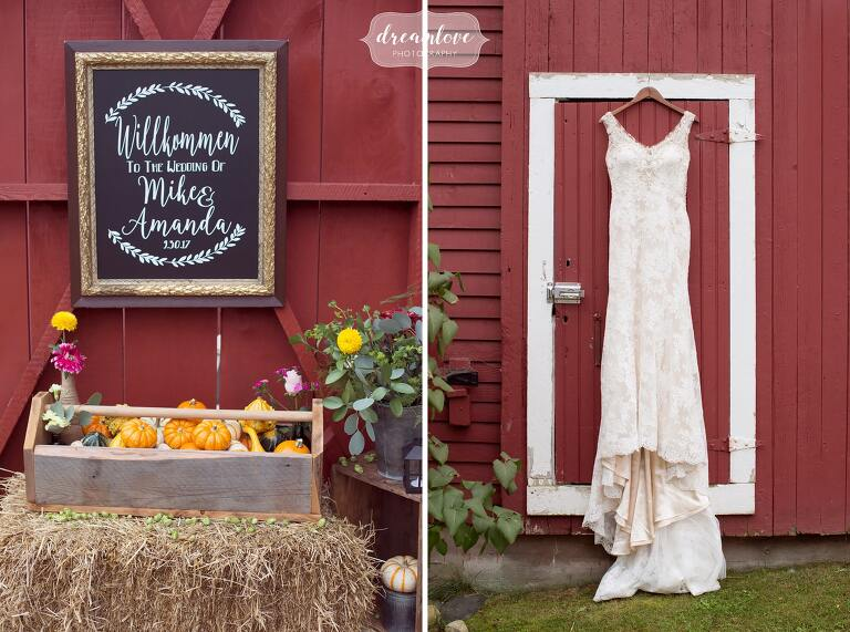This rustic NH barn wedding venue at Bishop Farm is perfect for chalkboard signs and the wedding dress hanging on the red barn door.