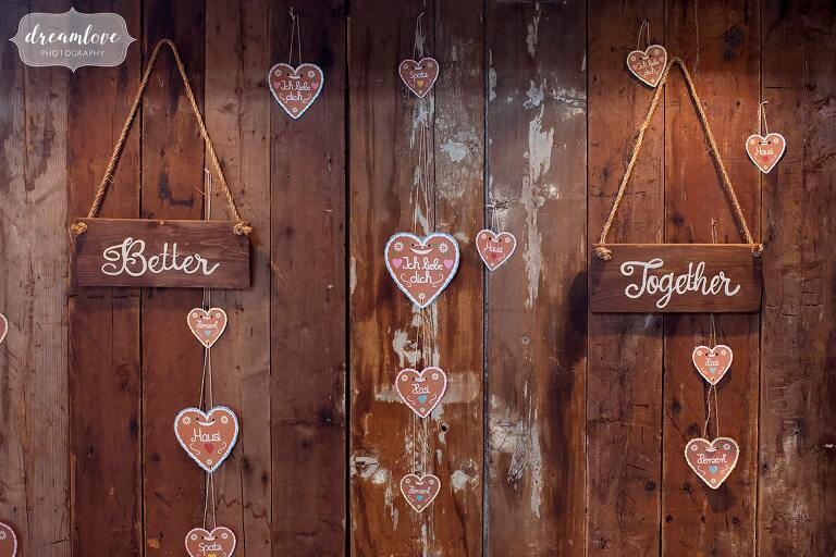 German signs are hung in the barn at this NH barn wedding space at Bishop Farm.