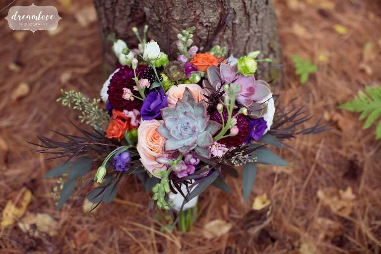 A wedding bouquet with succulents was perfect for this fall wedding at Bishop Farm.