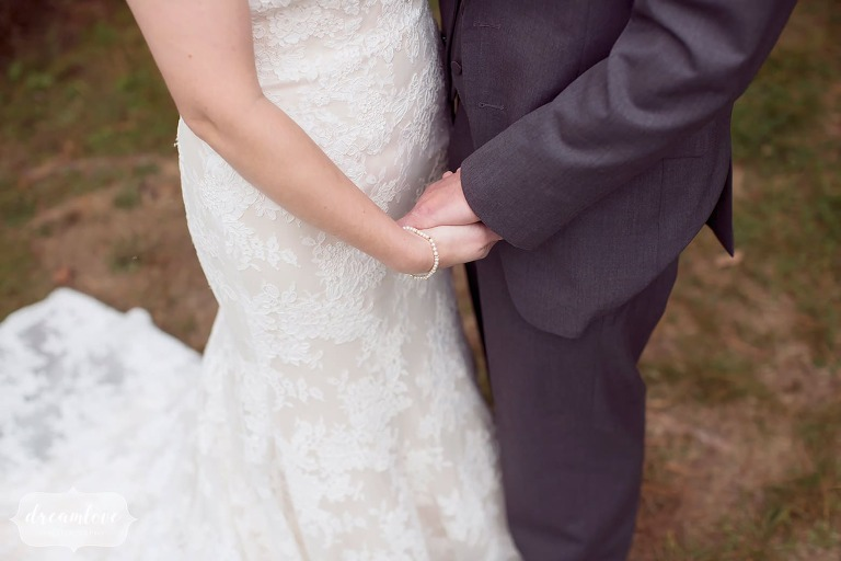 Romantic wedding photography of the bride and groom holding hands at Bishop Farm.